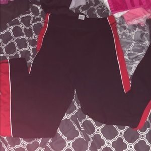 Black leggings with red and white side detail.